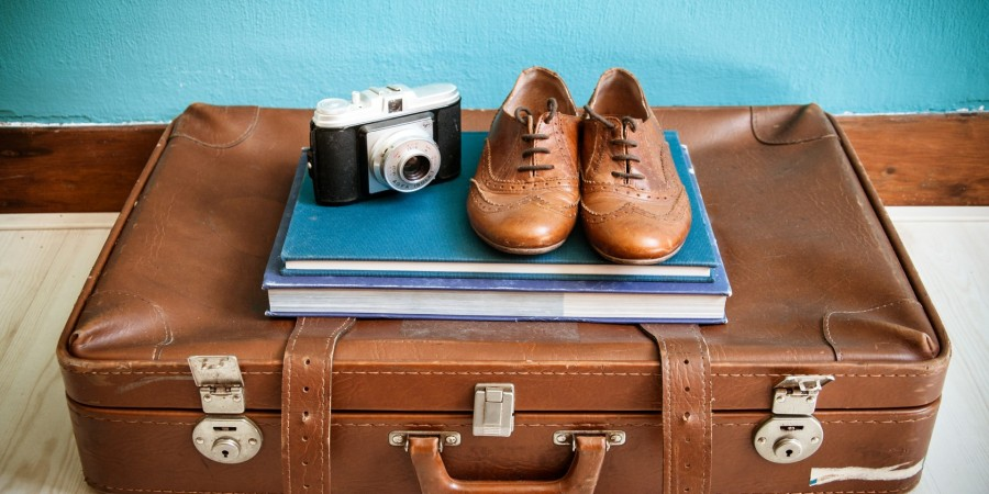 vintage still life with suitcase and shoes
